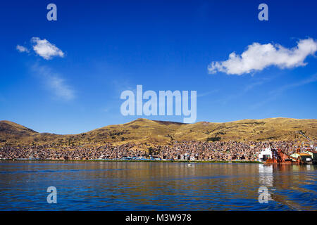 Panoramic view of Puno from the Titicaca lake, Peru - Stock Photo