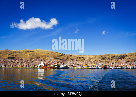 Panoramic view of Puno from the Titicaca lake, Peru - Stock Photo