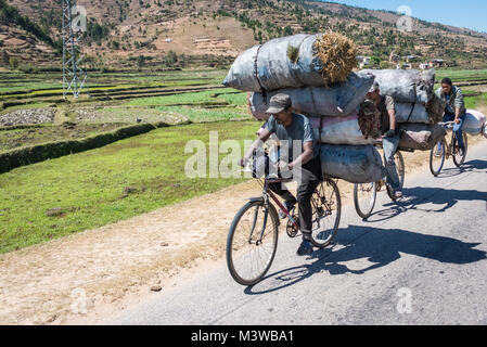 Bycicles Overloaded with Bags of Charcoal for Cooking, Southern Madagascar - Stock Photo