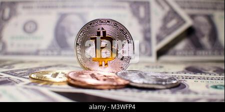 Bitcoin silver gold coin and onr dollar. - Stock Photo