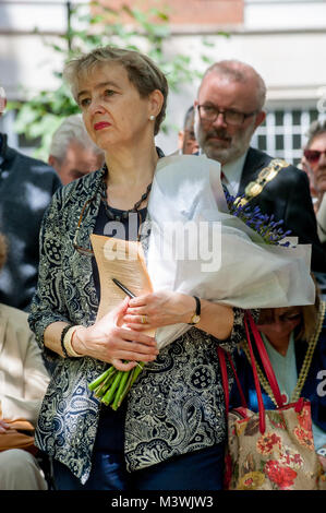 Kate Hudson, CND Chair holds the flowers she will later lay at the Hiroshima cherry tree at the annual commemoration - Stock Photo