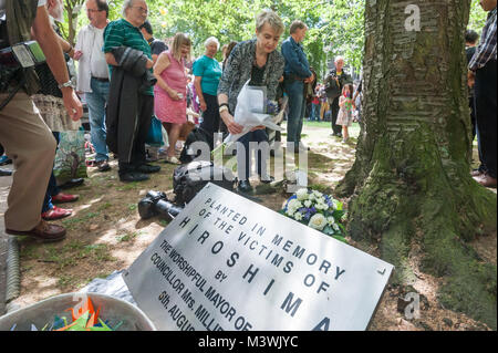 CND Chair Kate Hudson lays flowers at the Hiroshima cherry tree planted by Mayor Millie Miller in 1967 at the annual - Stock Photo
