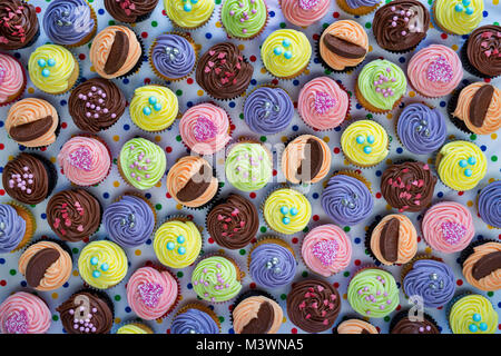 Colourful cupcakes on a polka dot background. Pattern - Stock Photo