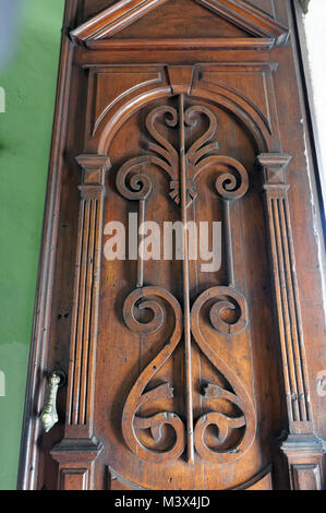 Ornately carved neoclassical style wooden door in the Government Palace, Merida, Yucatan, Mexico - Stock Photo