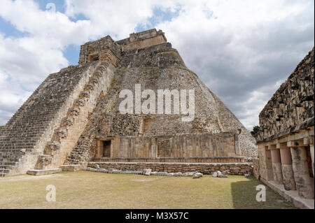Pyramid of the Magician and the Quadrangle of the Birds at the Mayan ruins of Uxmal, a UNESCO World Heritage Site, - Stock Photo