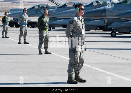 Air Force crew chiefs assigned to the 140th Maintenance Squadron with the Colorado Air National Guard wait for the - Stock Photo
