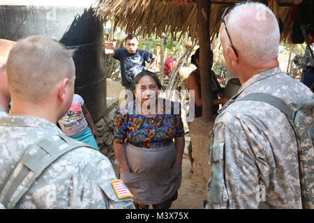 Master Sgt. John Barneson and Spc. Dennis Hoffman, assigned to the 318th PsyOp Company, speaks with a Guatemalan - Stock Photo