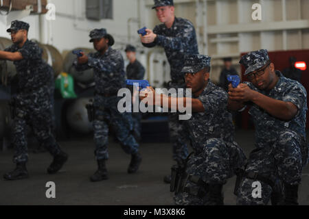 PACIFIC OCEAN (July 23, 2014) Sailors on board the aircraft carrier USS Nimitz (CVN 68) practice tactical movement - Stock Photo