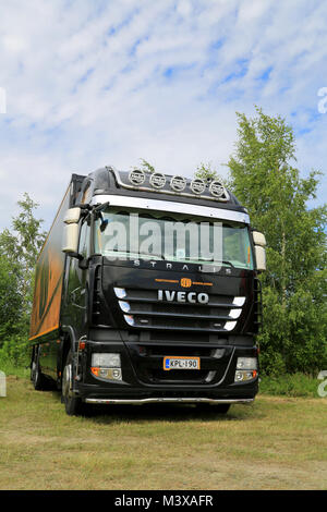 HATTULA, FINLAND - JULY 12, 2014: Black Iveco Stralis 450 trailer truck on display at Tawastia Truck Weekend in - Stock Photo