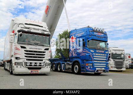 HATTULA, FINLAND - JULY 12, 2014: Three Scania heavy show trucks on display at Tawastia Truck Weekend in Hattula, - Stock Photo