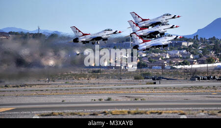 The U.S. Air Force Thunderbirds aerial demonstration team takes off for their performance Nov. 8, 2014, during an - Stock Photo