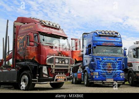 HATTULA, FINLAND - JULY 12, 2014: Volvo FH and Scania R620 timber show trucks on display at Tawastia Truck Weekend - Stock Photo