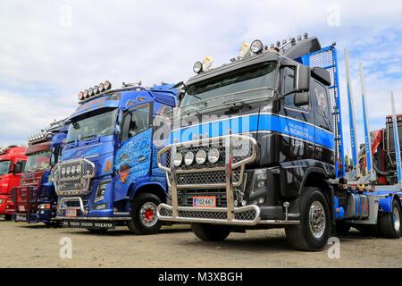 HATTULA, FINLAND - JULY 12, 2014: Row of heavy show trucks on display at Tawastia Truck Weekend in Hattula, Finland. - Stock Photo