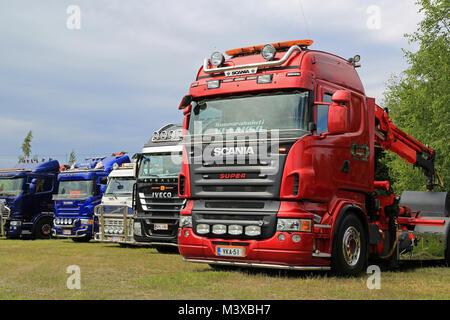HATTULA, FINLAND - JULY 12, 2014: Row of heavy show trucks displayed at Tawastia Truck Weekend in Hattula, Finland. - Stock Photo