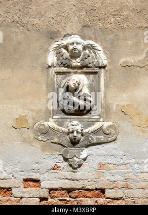 Carved relief on a stucco wall in Venice, 2017. - Stock Photo