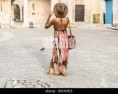 young beautiful woman using her telephone for taking images or video, maybe taking a self in the center of cuba, - Stock Photo