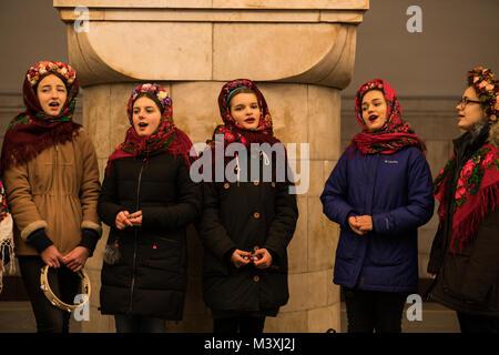 KIEV, UKRAINE - 14 JAN: The Young Girls in Ukrainian Traditional Ethnic Wear are Singing Carols at the Kiev Subway - Stock Photo
