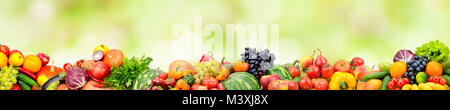 Panoramic collection fresh fruits and vegetables on green background. Free space for text. - Stock Photo