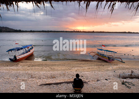 Scenic Landscape. Sunset at Gili Meno Island. Lombok, Indonesia. In the northwest of the island is the Café Diana, - Stock Photo
