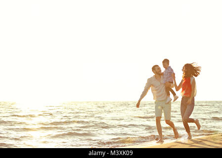 portrait of happy family and baby enjoying sunset in the summer leisure - Stock Photo