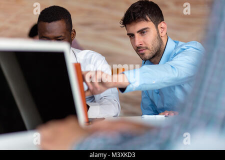 Two smart businessman using smartphone and laptop workig in office. - Stock Photo