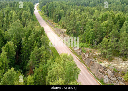 Highway in forest. Aland Islands, Finland - Stock Photo