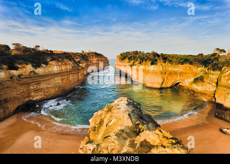 Overlooking secluded tiny Loch Ard Gorge beach in Twelve Apostles marine park on Shipwreck coast of Victoria, Australia. - Stock Photo