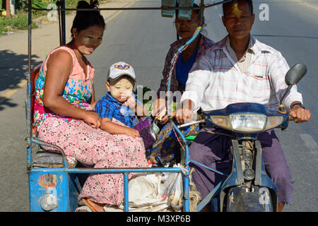 Hpa-An: Tuk-tuk (Thone Bee) taxi sidecar, mother, child, boy, face with thanaka cosmetic paste, , Kayin (Karen) - Stock Photo
