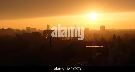 Panoramic Bucharest skyline seen from Pipera in warm sunset light. - Stock Photo