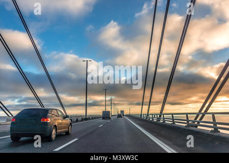 Traffic in the sunset on the bridge between Sweden and Denmark, December 17, 2017 - Stock Photo
