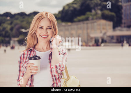 It's so wonderful place! Pretty cheerful with toothy smile carefree relaxed with blonde hair dressed in casual checkered - Stock Photo