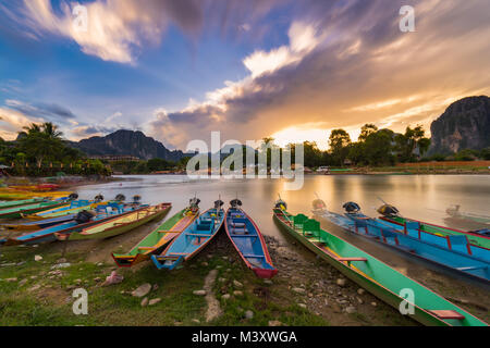 Long exposure and long tail boats on naw song river in Vang vieng, Laos. - Stock Photo