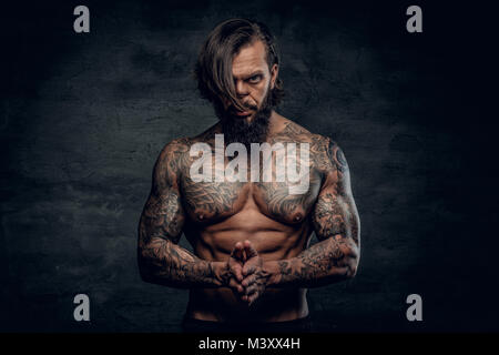 Portrait of a  man with tattooed body. - Stock Photo