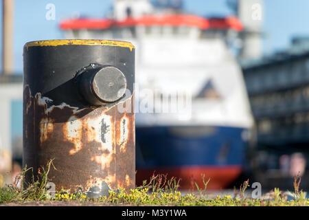 Empty bollard in harbor with cruise on blurred background, Helsinki, Finland - Stock Photo