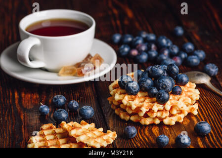 Cup of Tea with Blueberries and Belgian Waffles Stack on Wooden Background. - Stock Photo