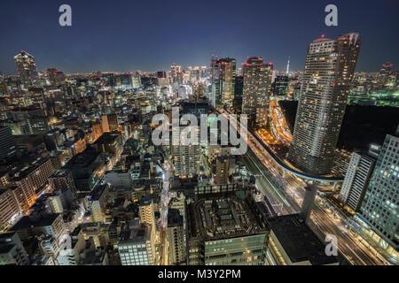 Night scene of Shiodome direction and Tokyo Skytree, Minato-Ku, Tokyo, Japan - Stock Photo