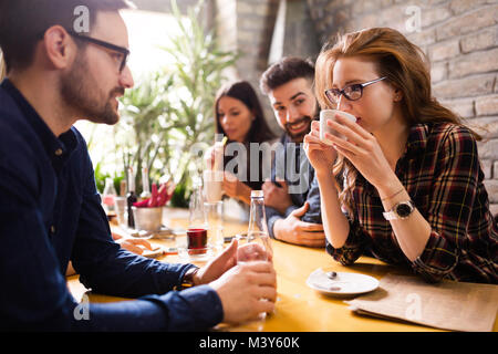 Happy young friends hangout in coffee shop - Stock Photo