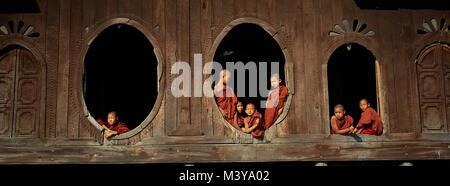 Myanmar (Burma), Shan State, Nyaung Shwe near Lake Inle, young monks at window of Shwe Yan Pyay (or Shwe Yam Pie) - Stock Photo