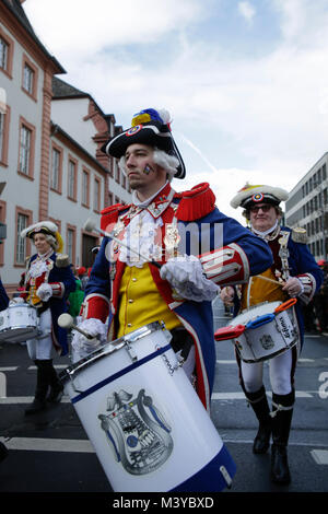 Mainz, Germany. 12th February 2018. A member of the marching band of the Mainzer Ranzengarde marches in the parade. - Stock Photo