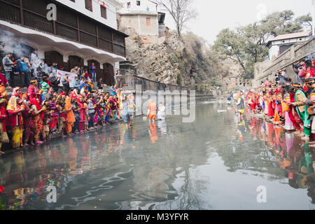 Kathmandu, Nepal. 12th Feb, 2018. Hindu devotees with bare feet and holy water pots offering Holy Water to Lord - Stock Photo