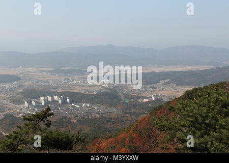 Gyeongju landscape with the buildings, mountains and paddy fields in autumn from Mt. Tohamsan, South Korea - Stock Photo