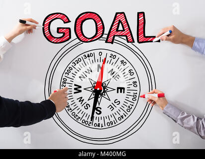 Business People's Hand Drawing Goal Concept And Compass Diagram On White Background - Stock Photo