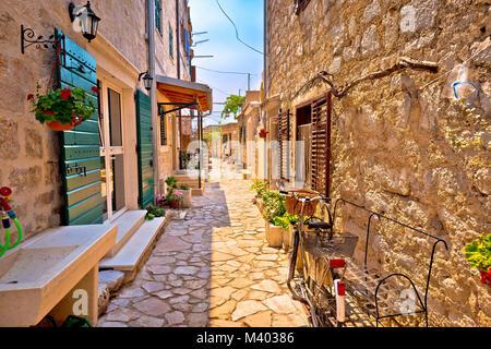 Colorful mediterranean stone street of Prvic island, Sibenik archipelago of Croatia - Stock Photo