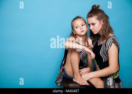 Portrait of two girls on a blue background 1 - Stock Photo