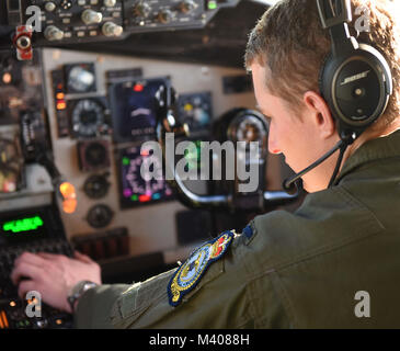 U.S. Air Force 1st Lt. Blake Kidd, 351st Air Refueling Squadron pilot puts coordinates into a KC-135 navigation - Stock Photo