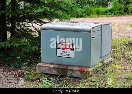 A danger high voltage sign on an electrical box. - Stock Photo