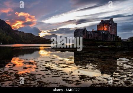 Firey Sunset at Eilean Donan Castle - Stock Photo