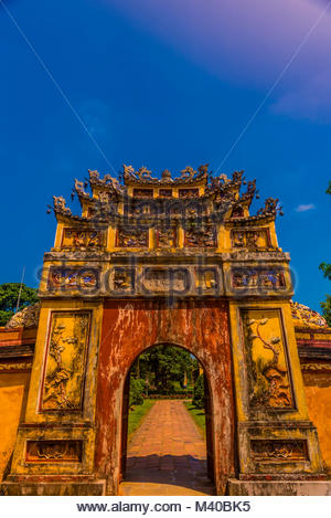 An ornate gate in the Imperial City, a walled palace within the citadel of the city of Huế which is the former imperial - Stock Photo