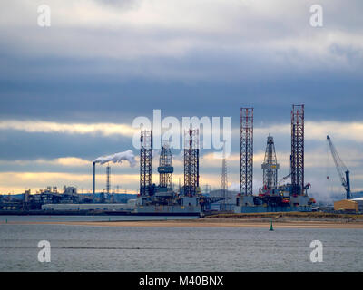 Jack Up drilling rigs Ensco 7 and 70 TERRC Hartlepool  facility on the river Tees for inspection and repair - Stock Photo