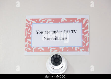 You Are Under CCTV Surveillance Sign with CCTV Camera notice posted at the official area. - Stock Photo